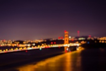 Golden Gate Bridge and city lights in bokeh